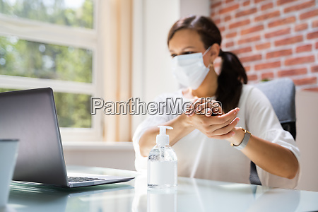 woman in face mask using
