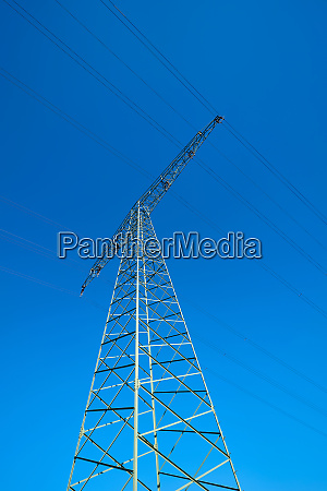 power pole on a field under
