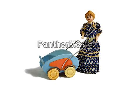 historical blonde doll in dark dress