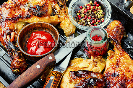 grilled chicken leg on grill