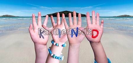 children hands building word kind means