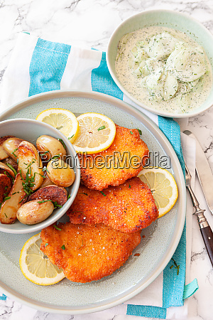 breaded chicken with baked potaoes