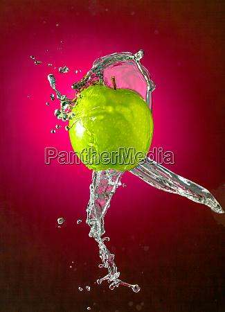 water splashes on apple