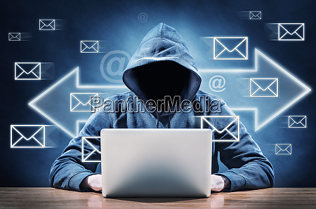 hacker using his computer for spreading