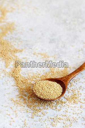 spoon of raw amaranth grain
