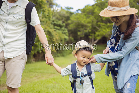 shy boy and parent hiking