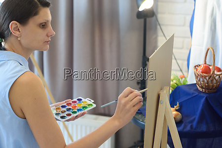 girl in the studio draws still