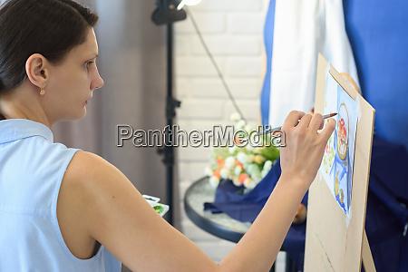 girl focuses on still life in