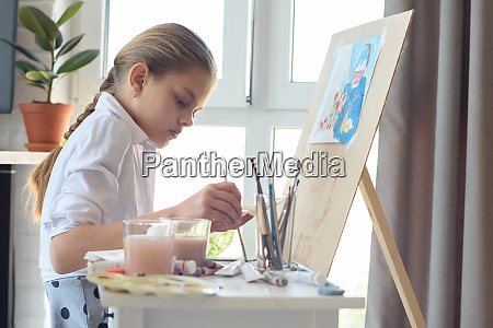 young artist draws in the studio