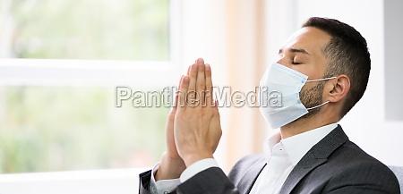 man prayer worshiping seeking god