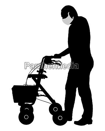 mann mit gesichtsmaske und rollator