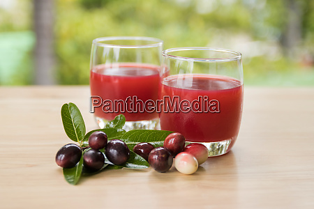 fresh carissa carandas glass of juice