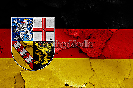 flags of saarland and germany painted