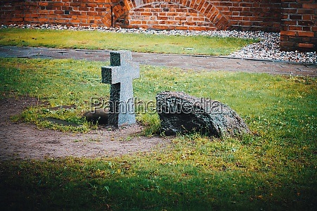 an ancient stone funeral cross and