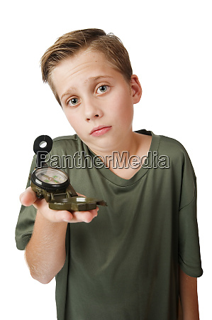 boy with compass inquiring look on