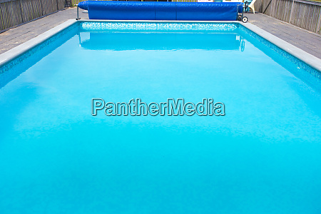 modern swimming pool with pool cover