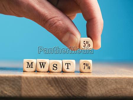 a businessman exchanges a wooden cube