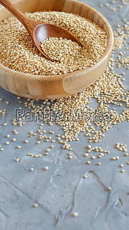 raw dry white quinoa seeds close