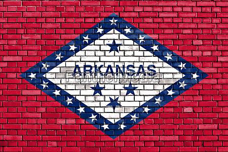 flag of arkansas painted on brick