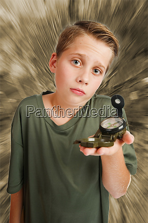 boy with compass inquiring look mono
