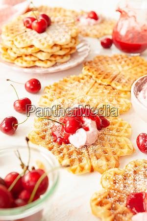 sweet waffles with fresh cherries