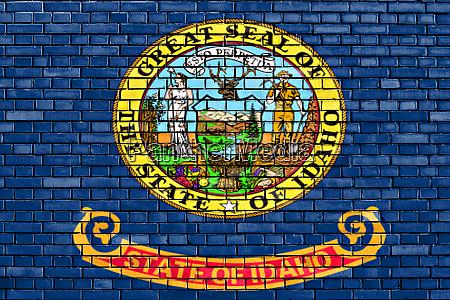 flag of idaho painted on brick