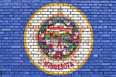 flag of minnesota painted on brick