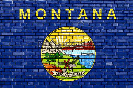 flag of montana painted on brick