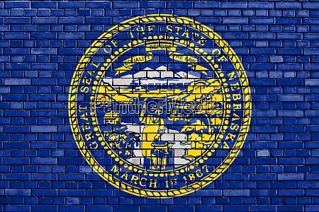 flag of nebraska painted on brick