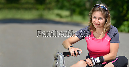 young woman fell on roller skates