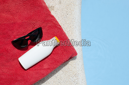summer concept with pool towel and