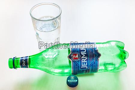 lying empty bottle of jermuk water