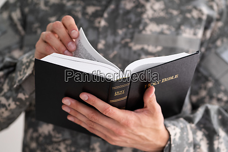 patriotic military army soldier reading bible