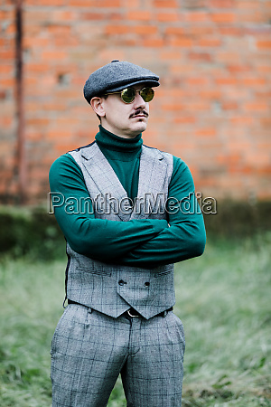 well dressed man wearing a grey