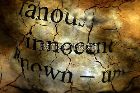 innocent text on grunge background