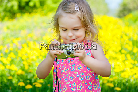 little girl taking pictures on a