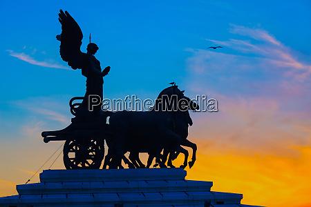 goddess victoria riding on quadriga rome