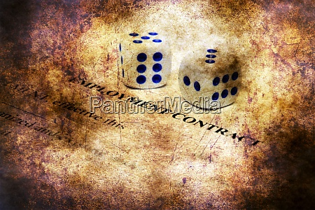 employment contract and dice on grunge