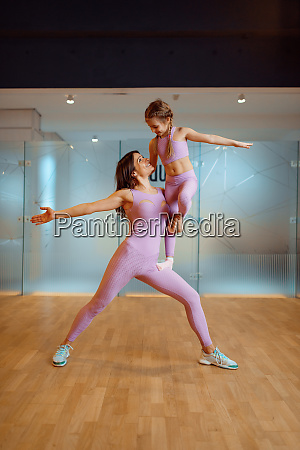 mother and daughter in gym healthy