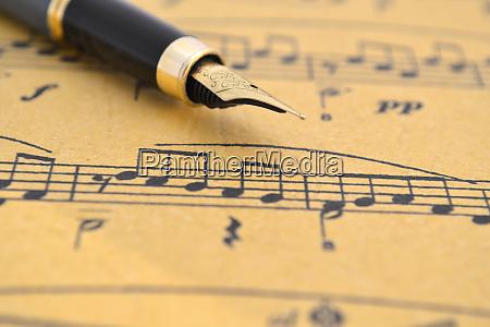 music sheet and fountain pen