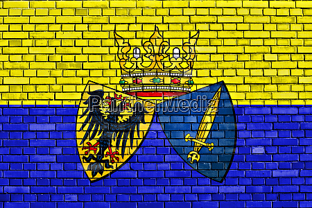 flag of essen painted on brick