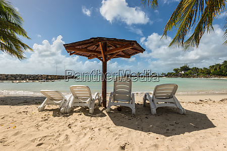 four chairs and umbrella on stunning