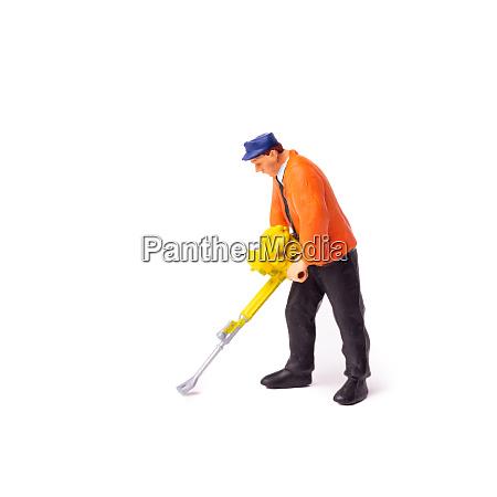 miniature builder worker with pneumatic hammer