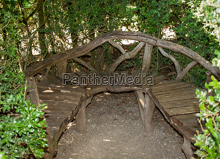 wooden bench in the gardens of
