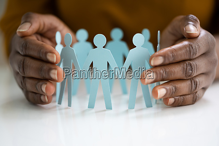 employee or insurer hand protecting figures