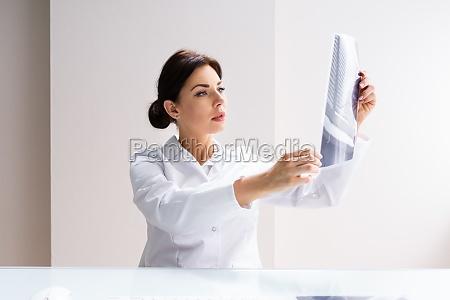 surgeon doctor holding knee bone xray