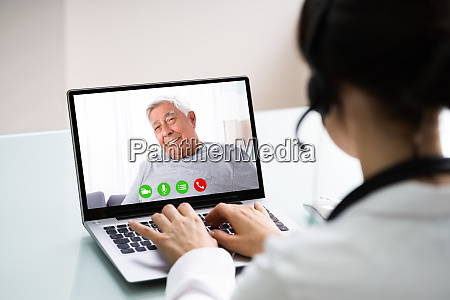 doctor talking to patient through video