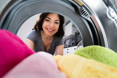 woman using washing machine appliance