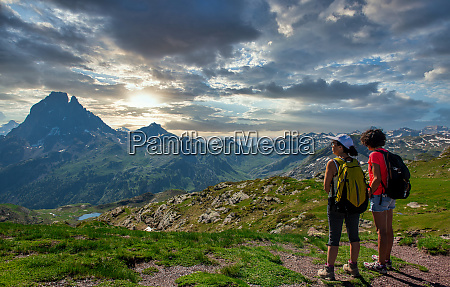 two hiker women in path of