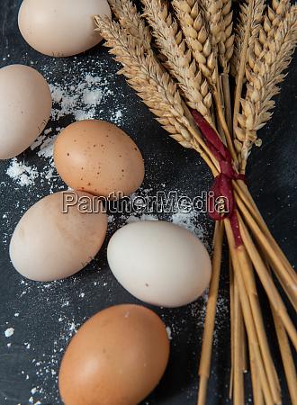 fresh eggs and some wheat ears